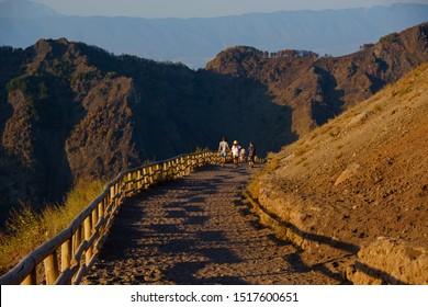 Vesuvius volcano crater next to Naples. Campania region, Italy. Popular Italian travel destination. Hiking trail on Vesuvius volcano.