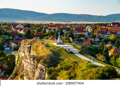 Veszprem, Hungary. Aerial view of monument from Castle hill in the evening in Veszprem, Hungary. Clear sky over the mountains