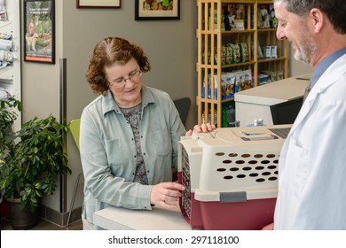 Vet discussing cat with owner
