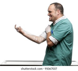 Vet putting on a plastic glove in front of white background