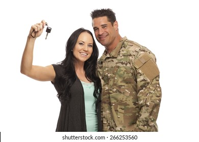 Veteran Soldier buying a car | Happy soldier with his wife holding car key against white background