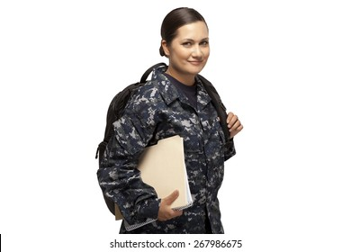 VETERAN SOLDIER | MILITARY COLLEGE BENEFITS | CASH FOR SCHOOL | Portrait of smiling female navy sailor with shoulder bag and books, using GI Bill money to go back to school.