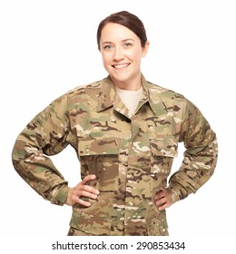 Veteran soldier Military female with hands on hips. Attractive Army soldier wearing camouflage on white background.