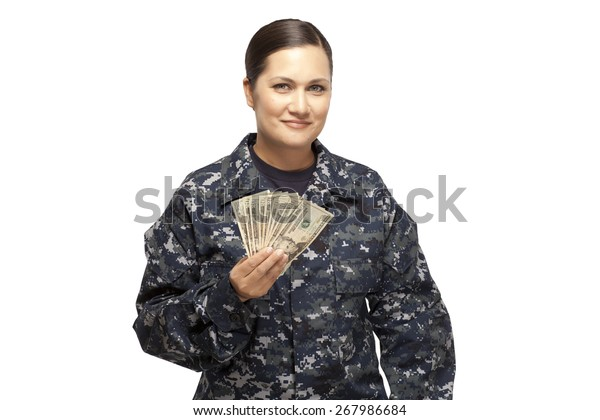 VETERAN SOLDIER   MONEY FOR COLLEGE   PAYDAY LOAN   MILITARY FUNDING  Portrait of smiling female navy sailor holding money against white background