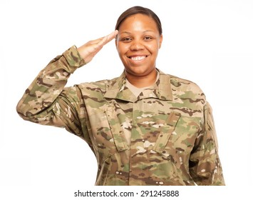 Veteran Soldier saluting and smiling. African American Woman in the military.