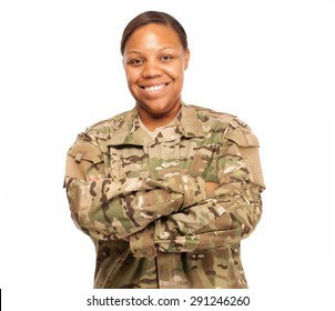 Veteran Soldier smiling with arms crossed. African American Woman in the military.