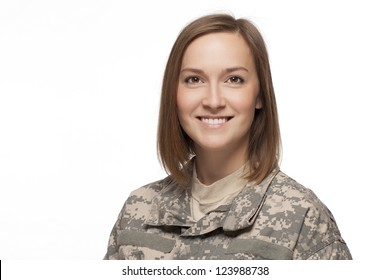Veteran soldier smiling in uniform.