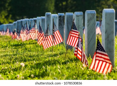 Veterans Cemetary with rows of tombstones and flags