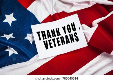 Veterans day greeting card on flag