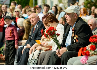 veterans of the great Patriotic war sitting in the stands and watch the parade on the Victory Day is a holiday in Russia.