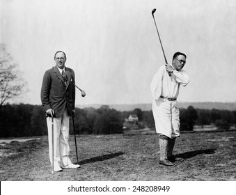 Veterans play par golf spite of their handicaps. 1920s. Colonel Charles R. Crosfield, who uses an artificial leg, and Gen. James A. Drain, in golf match at the Washington Golf and Country Club.