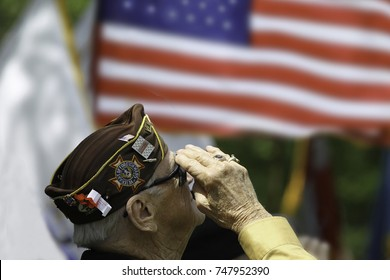 Veteran's saluting at a ceremony
