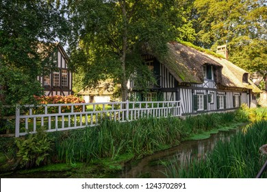 Veules les Roses , Normandy / France - September 2 2018: Thatched roof cottage along the veules river.
