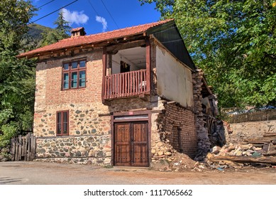 VEVCANI, MACEDONIA, BALKANS - OCTOBER 11, 2017: An old, damaged, traditional stone house with balcony. This town self-declared as The Republic of Vevcani, and is now a model country or micronation.