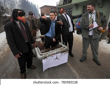 VEVCANI, MACEDONIA - JANUARY 13, 2017: Dressed up participants like an old tribe with sticks at Vevcani Carnival, southwestern Macedonia