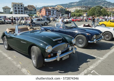 VEVEY, Switzerland - September 01: tourists visiting the exhibition of collection vintage cars on the Market Place in Vevey, Switzerland on September 01, 2015