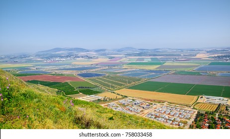 Vew from a hill to the Beit Shean Valley near the Nir David kibbutz, Israel, at spring season when agricultural areas has a most scenic look.