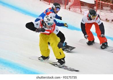 VEYSONNAZ, SWITZERLAND - JANUARY 19: Sivertzen (5) Holland (2) and Hale (37) neck and neck in the  FIS World Championship Snowboard Cross finals : January 19, 2012 in Veysonnaz Switzerland