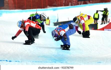 VEYSONNAZ, SWITZERLAND - JANUARY 22: l to r Dominique Maltais, Jekova, Jacobellis, Gillings at the finish FIS World Championship Snowboard Cross finals : January 22, 2012 in Veysonnaz Switzerland