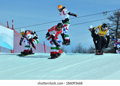 VEYSONNAZ, SWITZERLAND - MARCH 11: GODINO 10 (ITA) leading the pack in the Snowboard Cross World Cup: March 11, 2014 in Veysonnaz, Switzerland