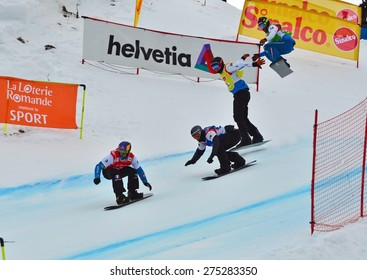 VEYSONNAZ, SWITZERLAND - MARCH 14:  Pierre VAULTIER (FRA) leads the pack in the finals of the Snowboard Cross World Cup: March 14, 2015 in Veysonnaz, Switzerland