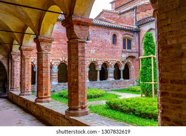 VEZZOLANO, ASTI, PIEDMONT, ITALY - May 25, 2015: View of cloister of the Abbazia of Santa Maria di Vezzolano in Albugnano, a medieval building in Piedmont, in Gothic and Romanesque style.