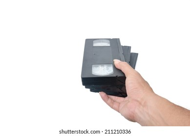 VHS cassette in hand isolated on white background