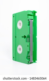 VHS tape on vertical with open cover and the magnetic tape exposed. Green VHS, Video Home System.