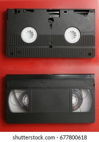 VHS video cassette both sides, isolated on red background, clipping path included
