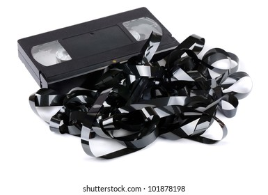 VHS video cassette with tangled video tape isolated on white