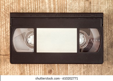 VHS video tape cassette on wooden background.Copy-space.
