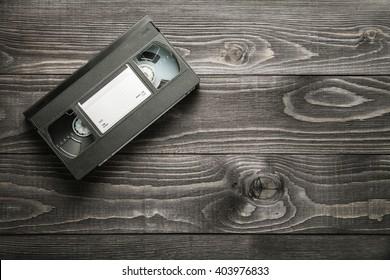 VHS videotape cassette on wooden rustic background