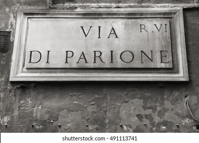Via di Parione - street sign in Rome, Italy. Parione district. Black and white retro style.