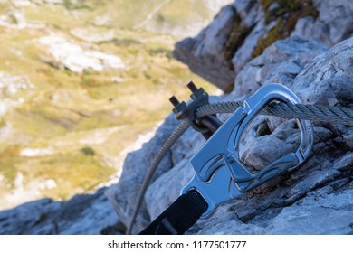 Via ferrata carabiner hooked to steel cable