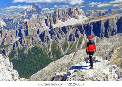 Via ferrata climber standing on Averau peak, Dolomite Alps, Italy
