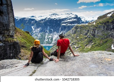 Via ferrata climbers sitting and resting on a cliff. Himmestigen via ferrata , way to Trolltunga , Norway, Europe
