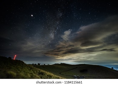 The Via Lactea is behind the clouds, taken at La Joya at the Izta-Popo national park in central Mexico, this view includes Mexico city at the bottom right and Cuernavaca city at the bottom left.