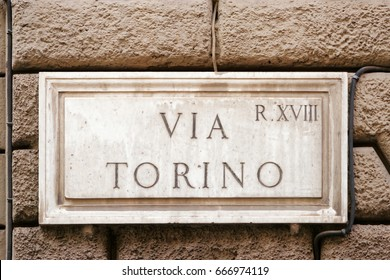 Via Torino street sign in the wall in Rome, Italy