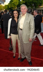 Viacom chairman & CEO SUMNER REDSTONE & date at the world premiere of K-19: The Widowmaker. 15JUL2002.   Paul Smith / Featureflash