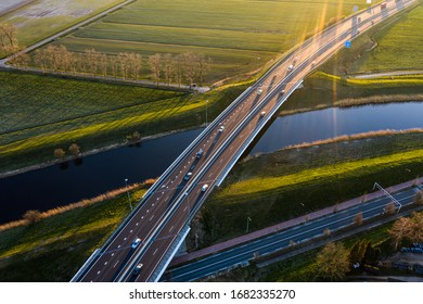 A viaduct bridge crossover a canal of highway A59 during sunrise near Waalwijk, Noord Brabant, Netherlands