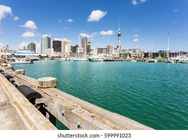 Viaduct harbour in the trendy Wynyard district in Auckland with the business district skyline and the sky tower in the background in New Zealand largest city on a sunny day.