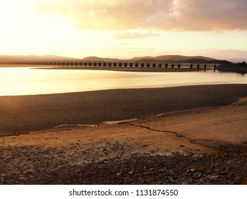 Viaduct over the Kent Estuary near Arnside, Cumbria, England, at sunset
