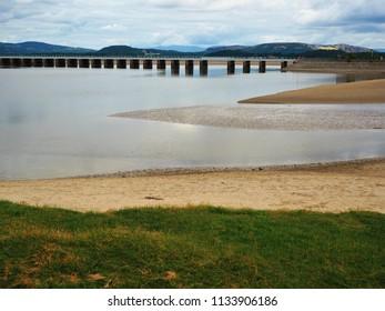 Viaduct over the Kent River estuary at high tide near Arnside, Cumbria, England