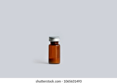 A vial (ampoule, container) with a drug (medicine powder) on a white background.