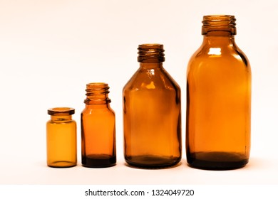 Vials on white background. Yellow vials. Medicine bottles on a white background.