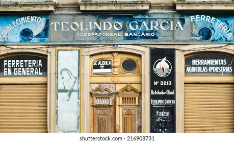 VIANA DO BOLO, SPAIN - JUNE 7, 2014: Facade of an old and closed, hardware supplies, and also correspondent banking business.