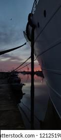Viana do Castelo harbor at sunset time.
