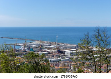 Viana do Castelo / Portugal - May 15, 2020: The view from the top of the Santa Luzia hill. Aerial view of Estaleiros Navais de Viana do Castelo (ENVC shipyard), Limia River and the Atlantic Ocean.