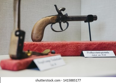 Vianden, Luxembourg - May 18, 2019: Old percussion pistol inside Vianden Castle, Luxembourg, one of the largest and finest feudal residences of the Roman and Gothic eras in Europe. Selective focus