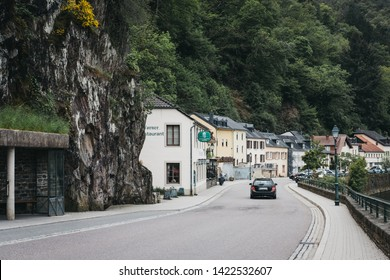 Vianden, Luxembourg - May 18, 2019: Car on a road in Vianden, town in Luxembourgs Ardennes region known for the centuries-old hilltop Vianden Castle.